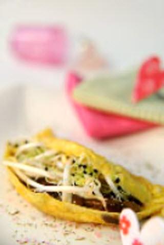 Receta de tortilla rellena de brotes y setas